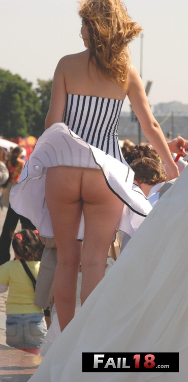 Nice clean pantie-less upskirt?thanks to the wind again?