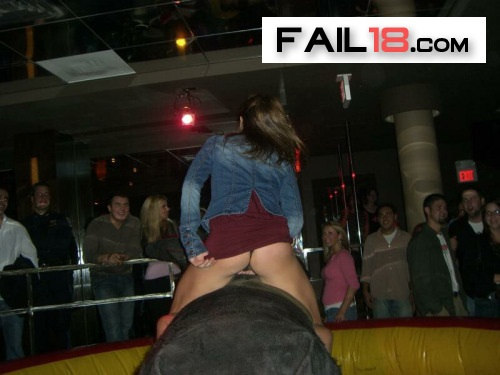 Hahahaha?trying to pull her skirt down?on a bucking bronco?